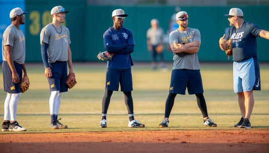 Montgomery Biscuits Manager Morgan Ensberg, right, works with players during a workout at Riverwalk Stadium in Montgomery, Ala., on Tuesday April 2, 2019. The first home game of the season for the Biscuits in Wednesday April 10th.