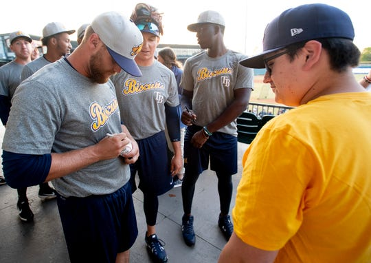 Montgomery Biscuits players sign autographs after a workout at Riverwalk Stadium in Montgomery, Ala., on Tuesday April 2, 2019. The first home game of the season for the Biscuits in Wednesday April 10th.