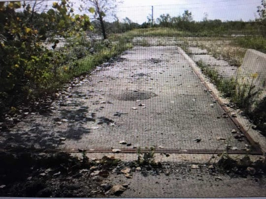 The former CR3 tire-recycling site is covered with vegetation and concrete slabs today.