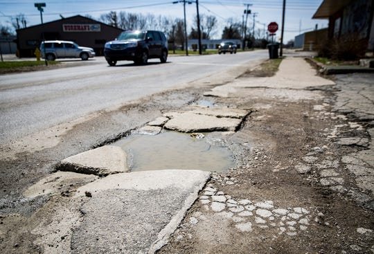 A destroyed section of sidewalk on Hoyt Avenue in this file photo.