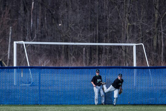 Yorktown's Grahm Reedy, right, throws back into the infield with Josh Stevenson looking on against Delta at Delta High School Tuesday, April 2, 2019.