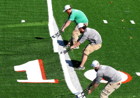 The turf is pulled into place.
