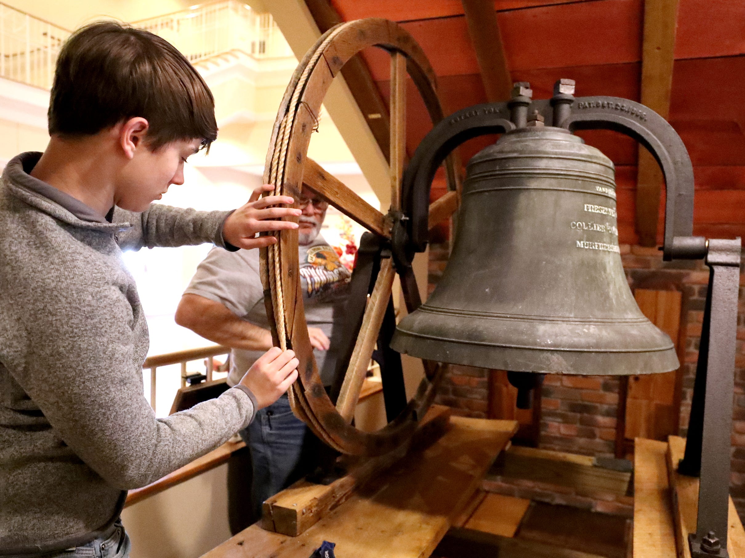 Andrew Gaines, 14  adjusts the rope for the old First Methodist Bell  as he and some other church members install the bell from the former First Methodist Church site in downtown Murfreesboro, to the new site on Thompson Lane, on Tuesday April 2, 2019.