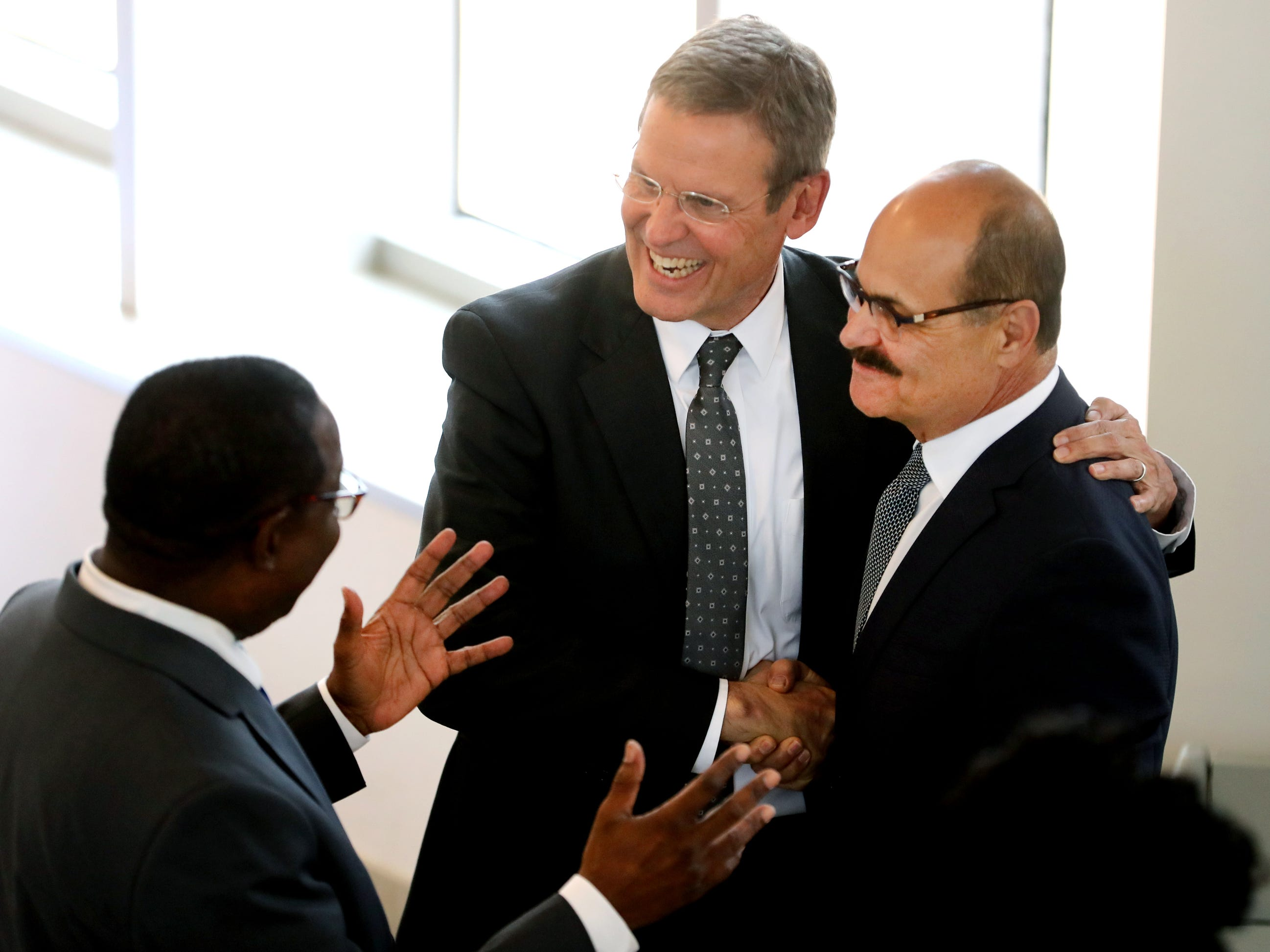 Tennessee Governor Bill Lee, center talks with MTSU president Sidney McPhee, left and Charlie Lico, right before Lee spoke at MTSU's program recognizing the Siemens' grant to MTSU's Mechatronics Engineering program, on Wednesday April 3, 2019.