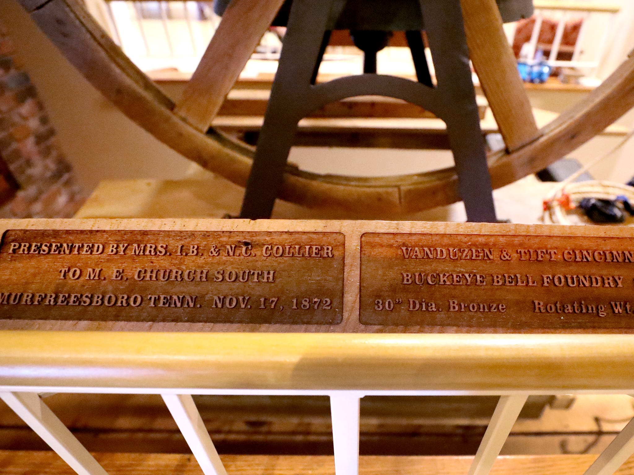 Wooden plaques that have information about the history of the old First Methodist Church bell are installed next to the new site of the First Methodist Church with the bell, on Tuesday April 2, 2019.
