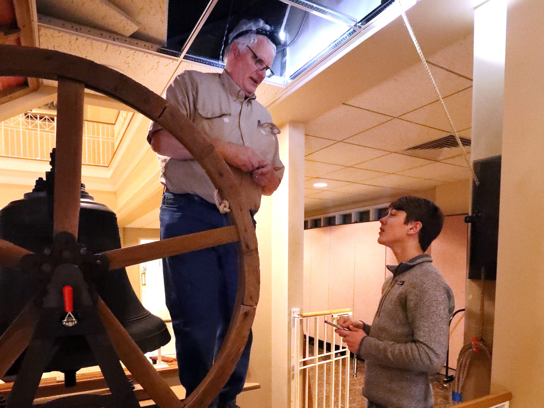 Robin Robertson, left and Andrew Gaines, 14, right install the old bell that was once located in the former First Methodist Church site in downtown Murfreesboro, to the new church site on Thompson Lane, on Tuesday April 2, 2019.