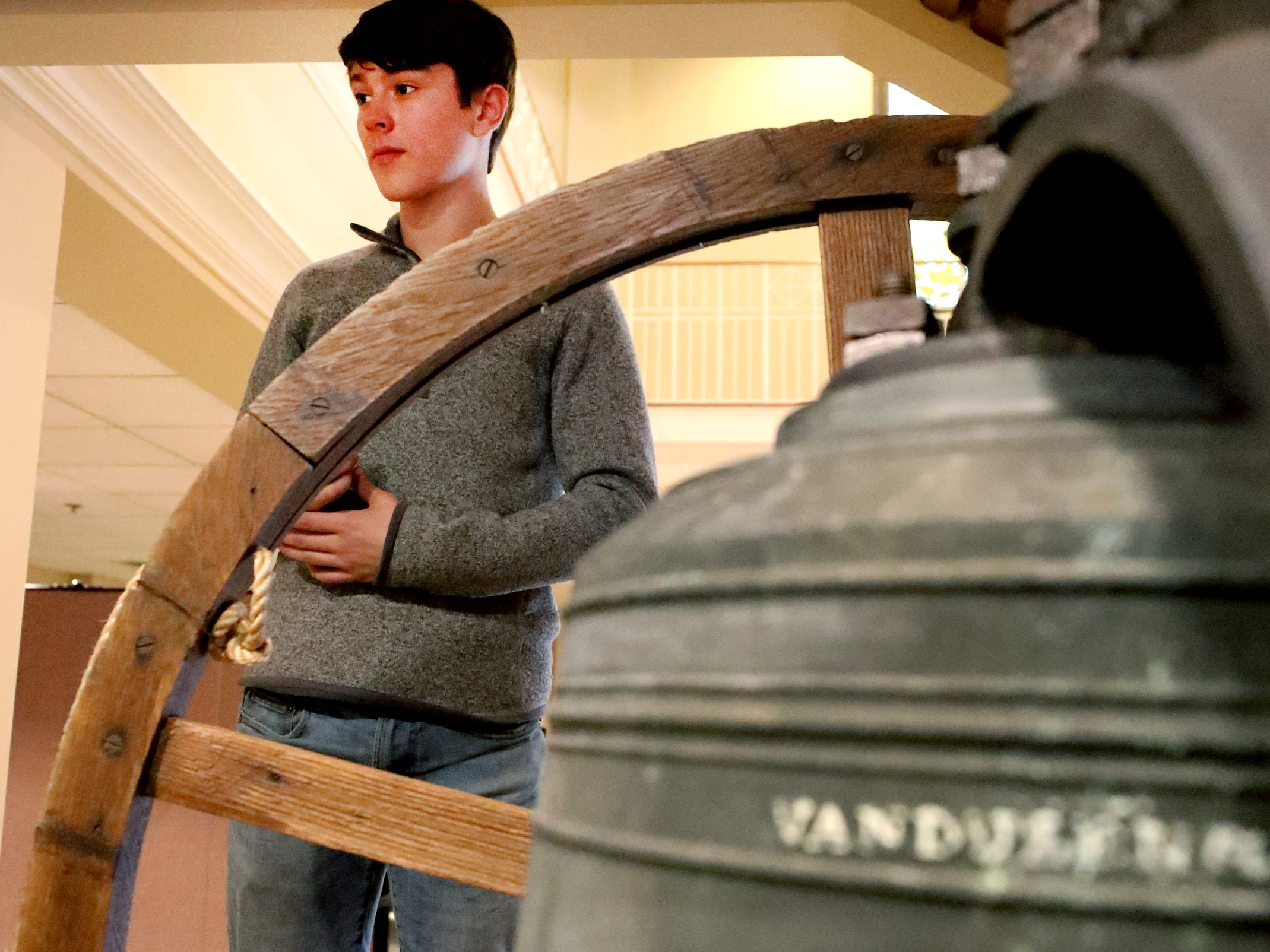 Andrew Gaines, 14 helps installs the old bell from the former First Methodist Church, in downtown Murfreesboro to the new First Methodist Church site in downtown Murfreesboro, on Thompson Lane, on Tuesday April 2, 2019.