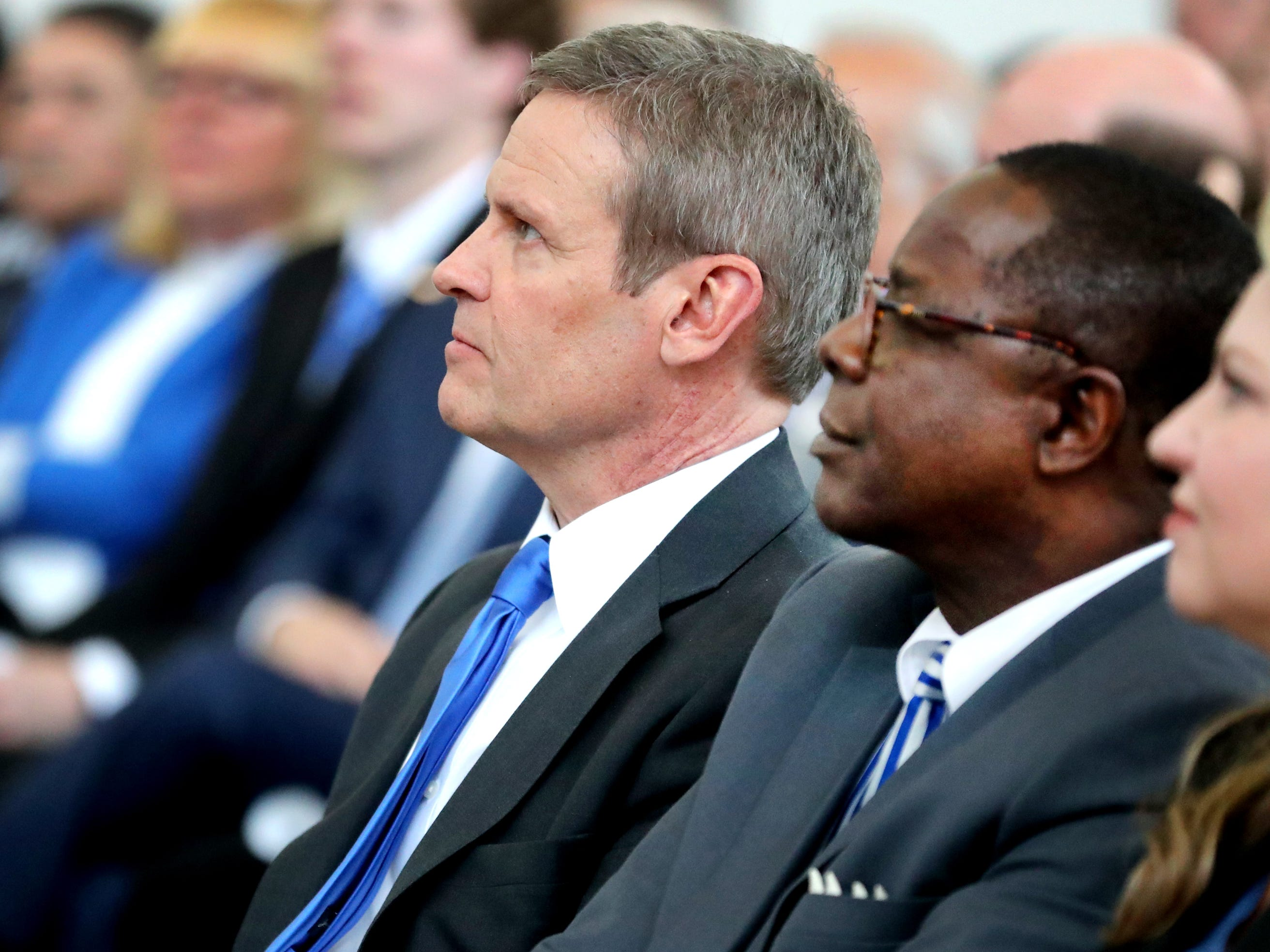 Tennessee Governor Bill Lee, left, and MTSU President Sidney McPhee sit next to each other during an MTSU program recognizing the Siemens' grant to MTSU's Mechatronics Engineering program, on Wednesday April 3, 2019.