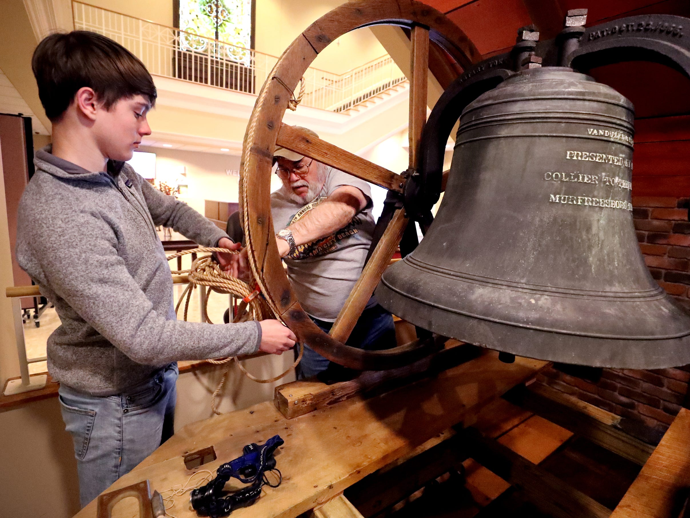 Andrew Gaines, 14, and Ron Lindsey adjusts the rope for the old First Methodist Bell as they install the bell from the former First Methodist Church site in downtown Murfreesboro, to the new site on Thompson Lane, on Tuesday April 2, 2019.