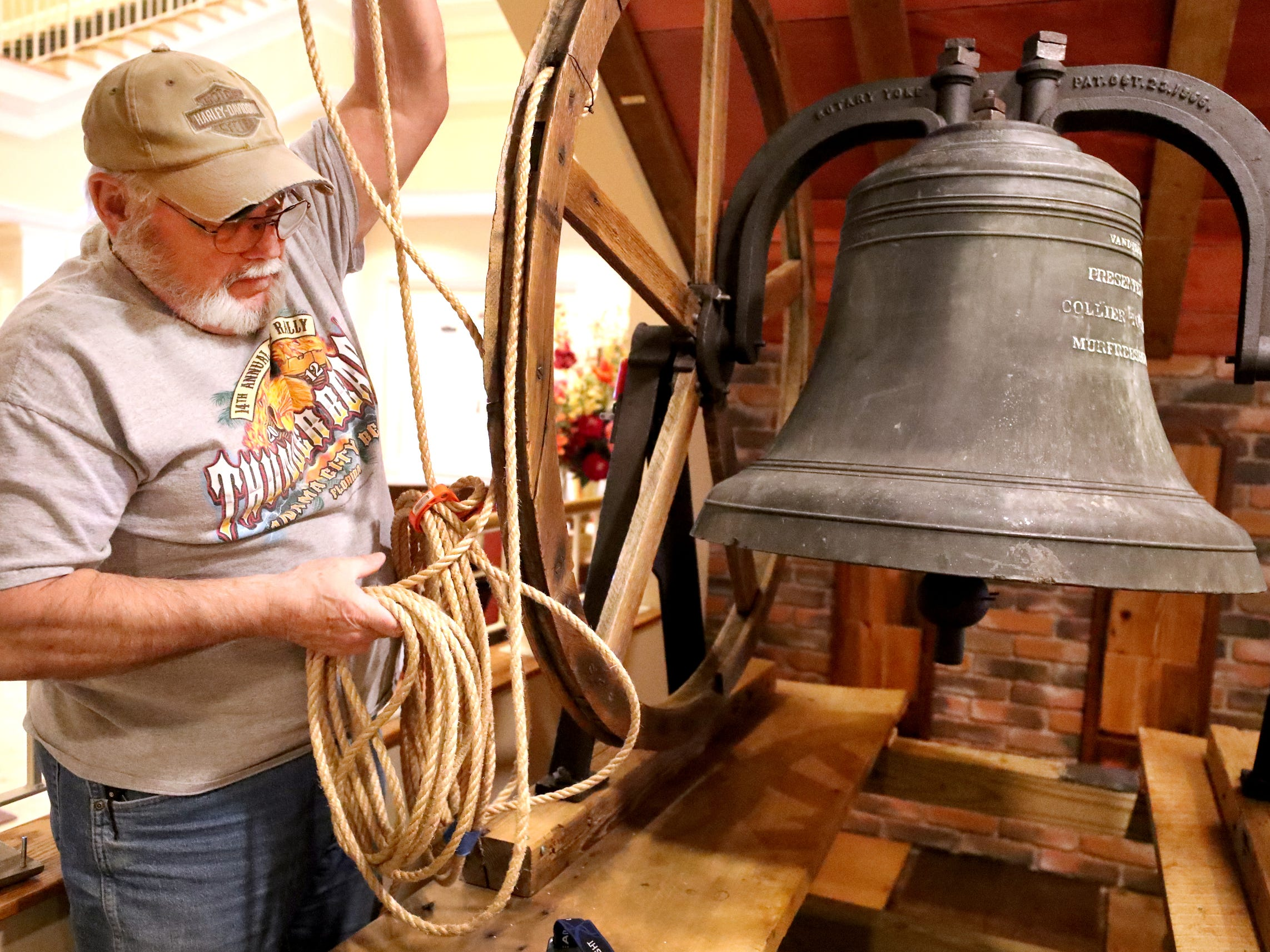 Ron Lindsey adjusts the rope for the old First United Methodist Church bell as he and other church members install the bell at the church's new site on Thompson Lane, on Tuesday April 2, 2019.