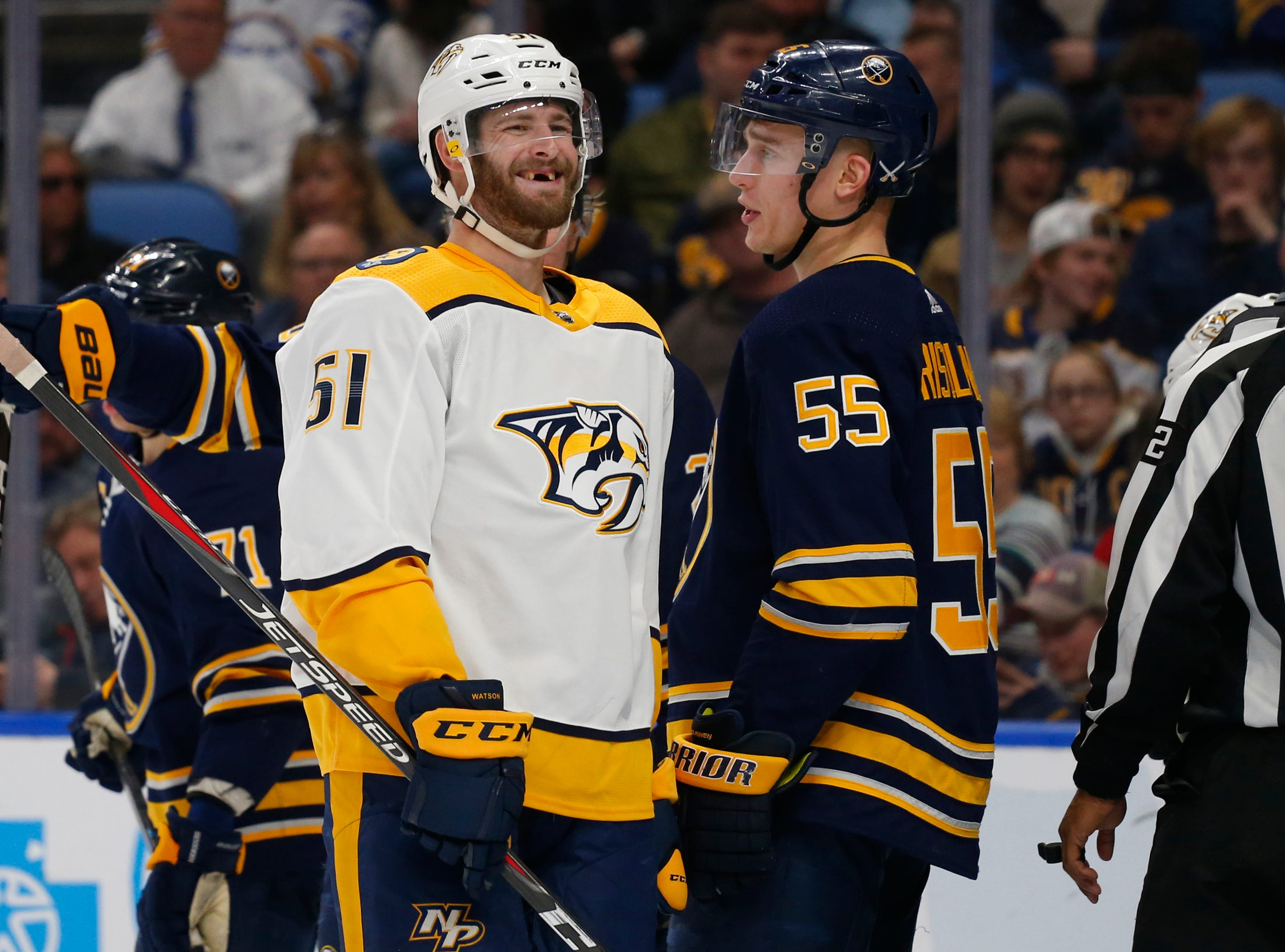 Buffalo Sabres defenseman Rasmus Ristolainen (55) and Nashville Predators forward Austin Watson (51) exchange words during the second period of an NHL hockey game Tuesday, April 2, 2019, in Buffalo, N.Y.