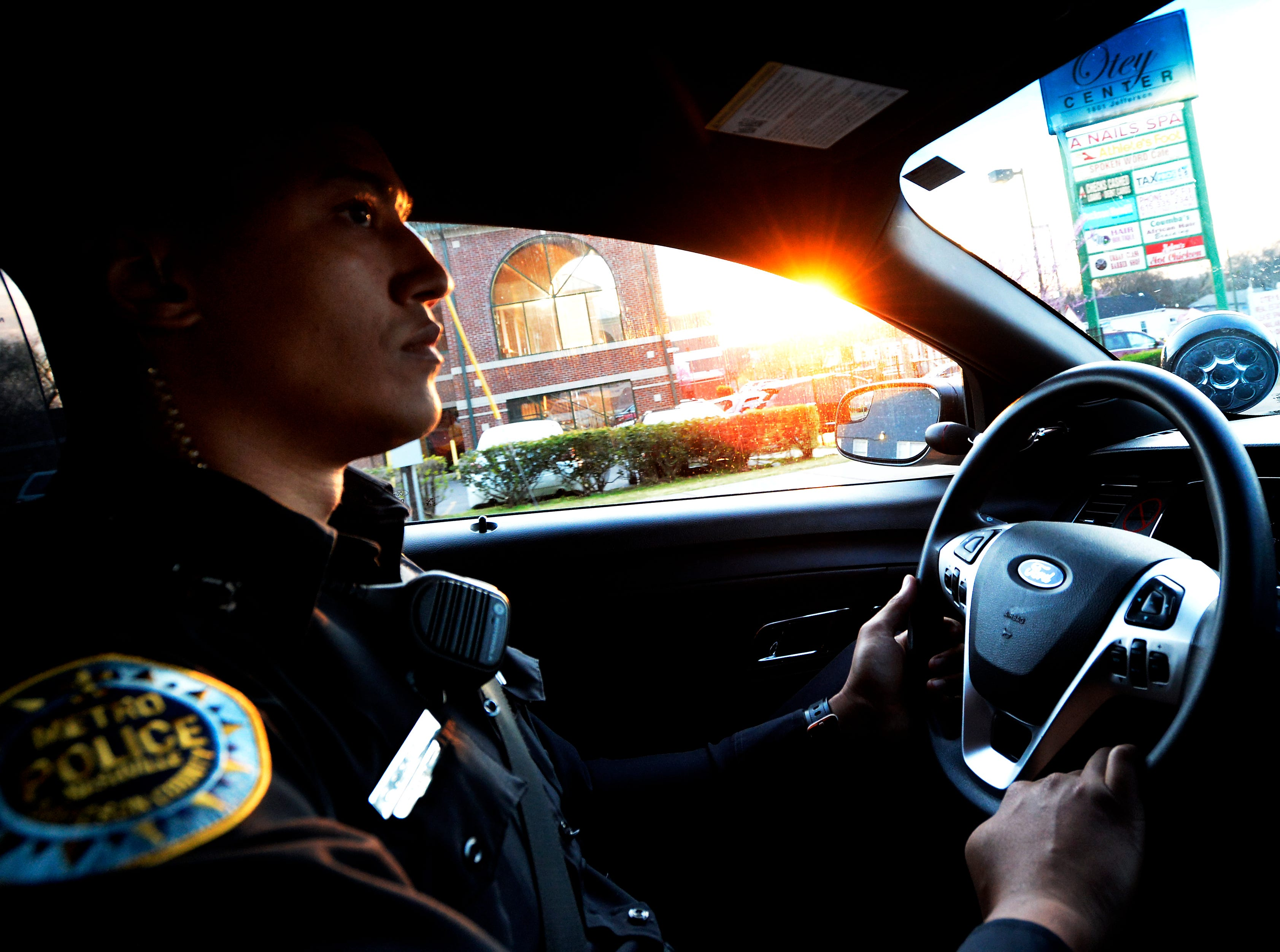 """Metro Nashville police officer Chris Dickerson drives in his police unit on Monday, April 1, 2019 in Nashville, Tenn. During the """"fixed post"""" time of his shift, Dickerson spends about 30 minutes in different areas of the north precinct visiting with people in the neighborhood."""