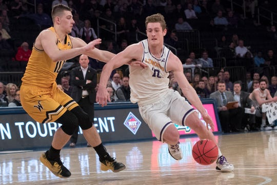 Lipscomb guard Jake Wolfe, right, drives to the basket against Wichita State guard Erik Stevenson during the first half of the semifinal in the National Invitational Tournament, Tuesday, April 2, 2019, at Madison Square Garden in New York.