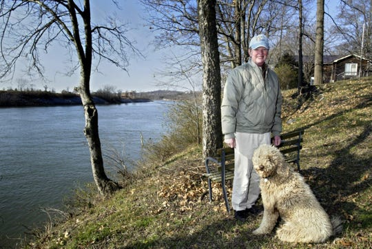 Chip Healy and his poodle Willie, here Jan. 29, 2007, lived in one of several cottages on Healy's land by the river in Nashville. Healy ran an addiction recovery program in Nashville.