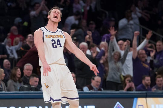 Lipscomb guard Garrison Mathews reacts after scoring a 3-pointer, bringing Lipscomb ahead in the last minutes of the second half of the semifinal in the National Invitational Tournament against Wichita State, Tuesday, April 2, 2019, at Madison Square Garden in New York. Lipscomb won 71-64.