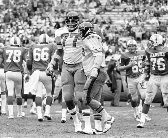 Vanderbilt's Dennis Harrison (77) and Tom Galbierz (54) walk off the field after making a big stop against Texas Tech in the 1974 Peach Bowl. Harrison was voted the game's Most Valuable Defensive Player for his performance in the game.
