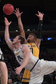 Wichita State guard Dexter Dennis (0) fouls Lipscomb guard Garrison Mathews (24) during the first half of the semifinal in the National Invitational Tournament, Tuesday, April 2, 2019, at Madison Square Garden in New York.