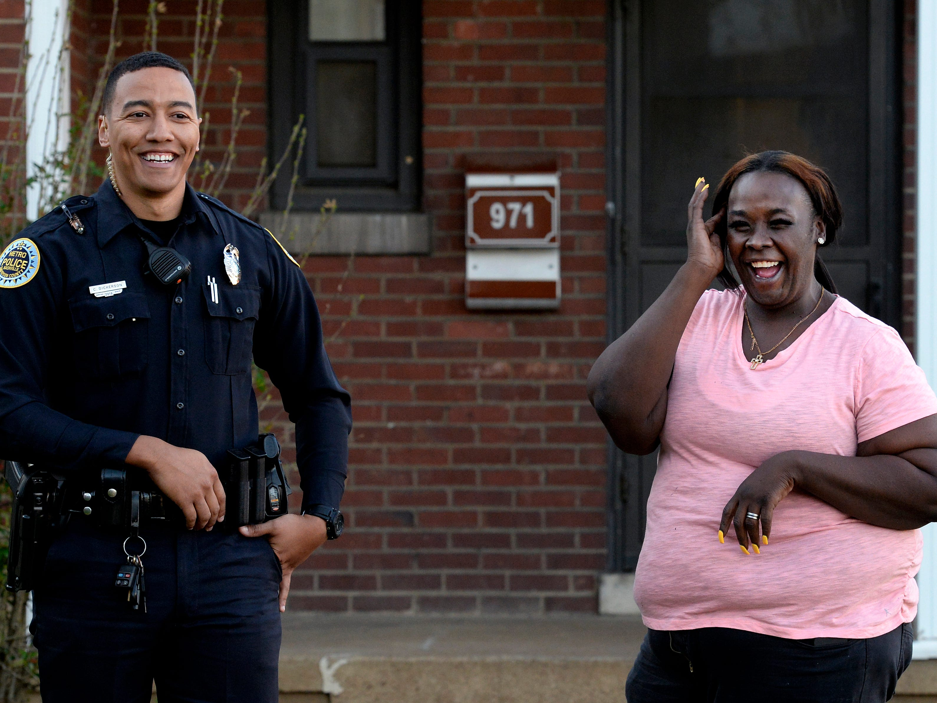 """Metro Nashville police officer Chris Dickerson talks with Tiffany Woodard outside her apartment on Blank Street on Monday, April 1, 2019 in Nashville, Tenn. During the """"fixed post"""" time of his shift, Dickerson spends about 30 minutes in different areas of the north precinct visiting with people in the neighborhood."""