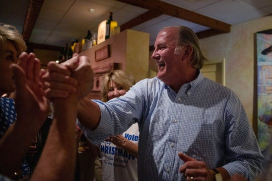 Ray Christman reacts at his watch party at Ridgway Bar and Grill in Naples on Tuesday, April 2, 2019, to hearing he won the special election for a seat on the Naples City Council.