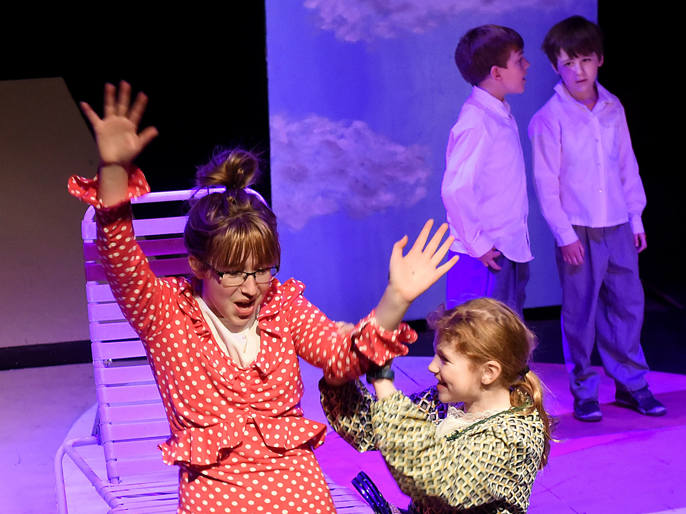 Avamarie Hedrick and Jennalyn Shafer fight for attention on stage as cruel Aunts Spiker and Sponge during a rehearsal for Weathervane Young Artists' Repertory Theatre's production of James and the Giant Peach. The musical, based on the novel by Roald Dahl, begins on Friday, April 5.