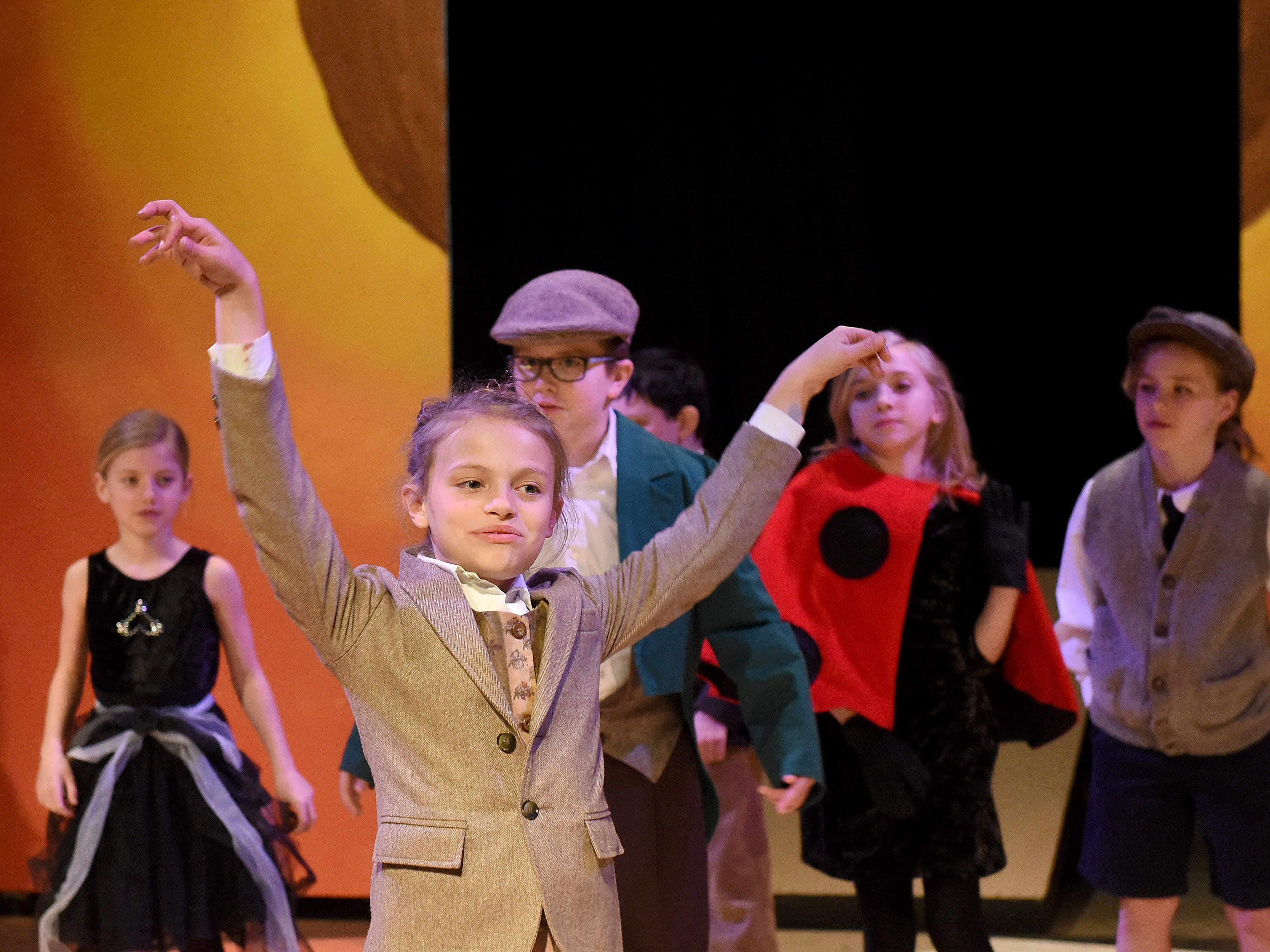 """Skye Biemesderfer, as the Earthworm, sings """"Plump and Juicy"""" as she attempts touse herself as bait for nearby seagulls to make the peach take flight during a rehearsal for Weathervane Young Artists' Repertory Theatre's production of James and the Giant Peach. The musical, based on the novel by Roald Dahl, begins on Friday, April 5."""