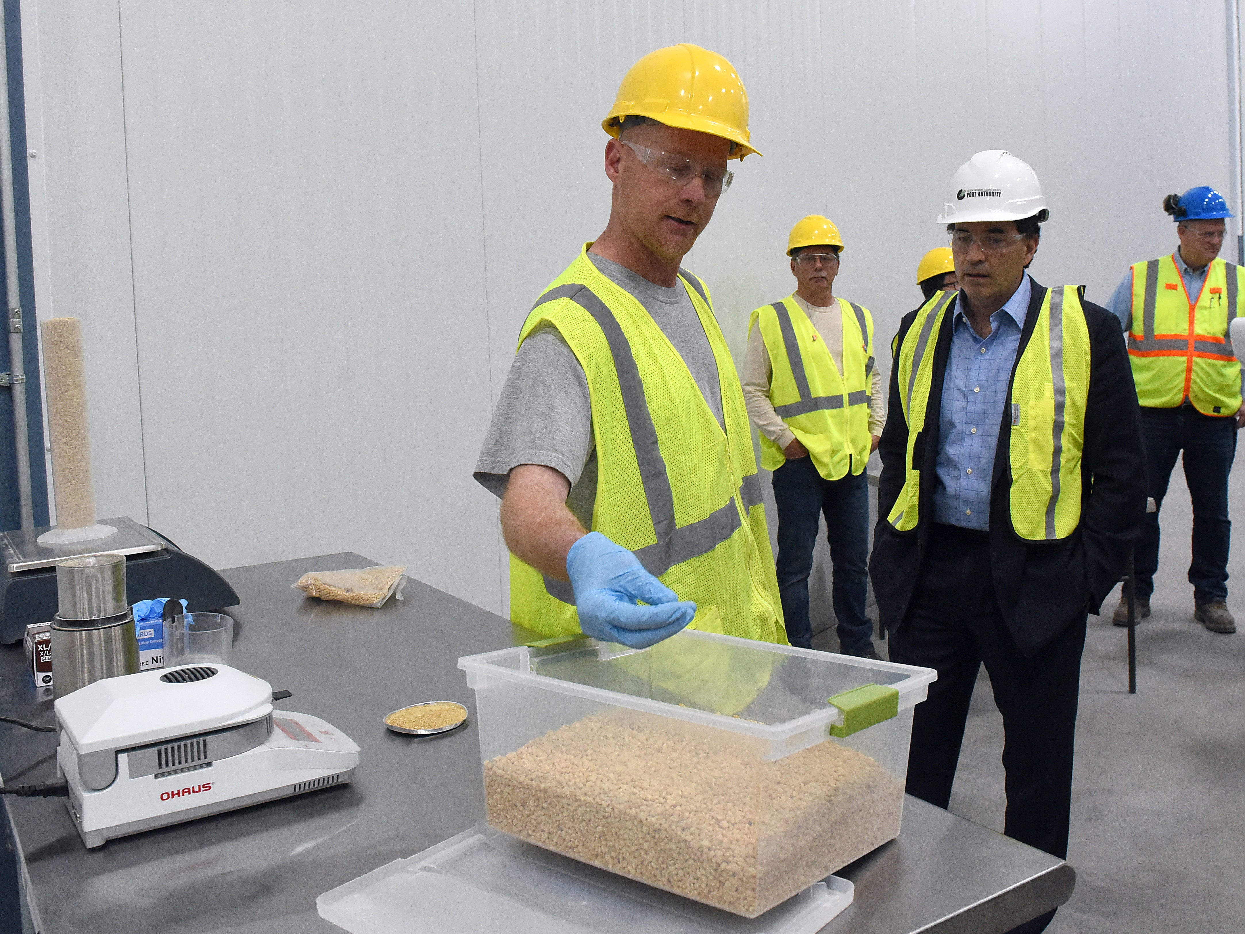 Brad Shepler with some of the finished cereal product made from non-GMO soy at GB Food.