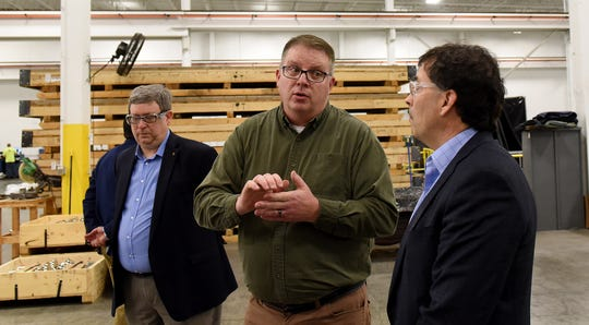 Mike Jones (center), general manager of Mistras Group, gives a tour of the company, which does x-ray, ultrasound and immersion testing for the aerospace industry, to executive director of the Port Authority Rick Platt and U.S. Rep. Troy Balderson.