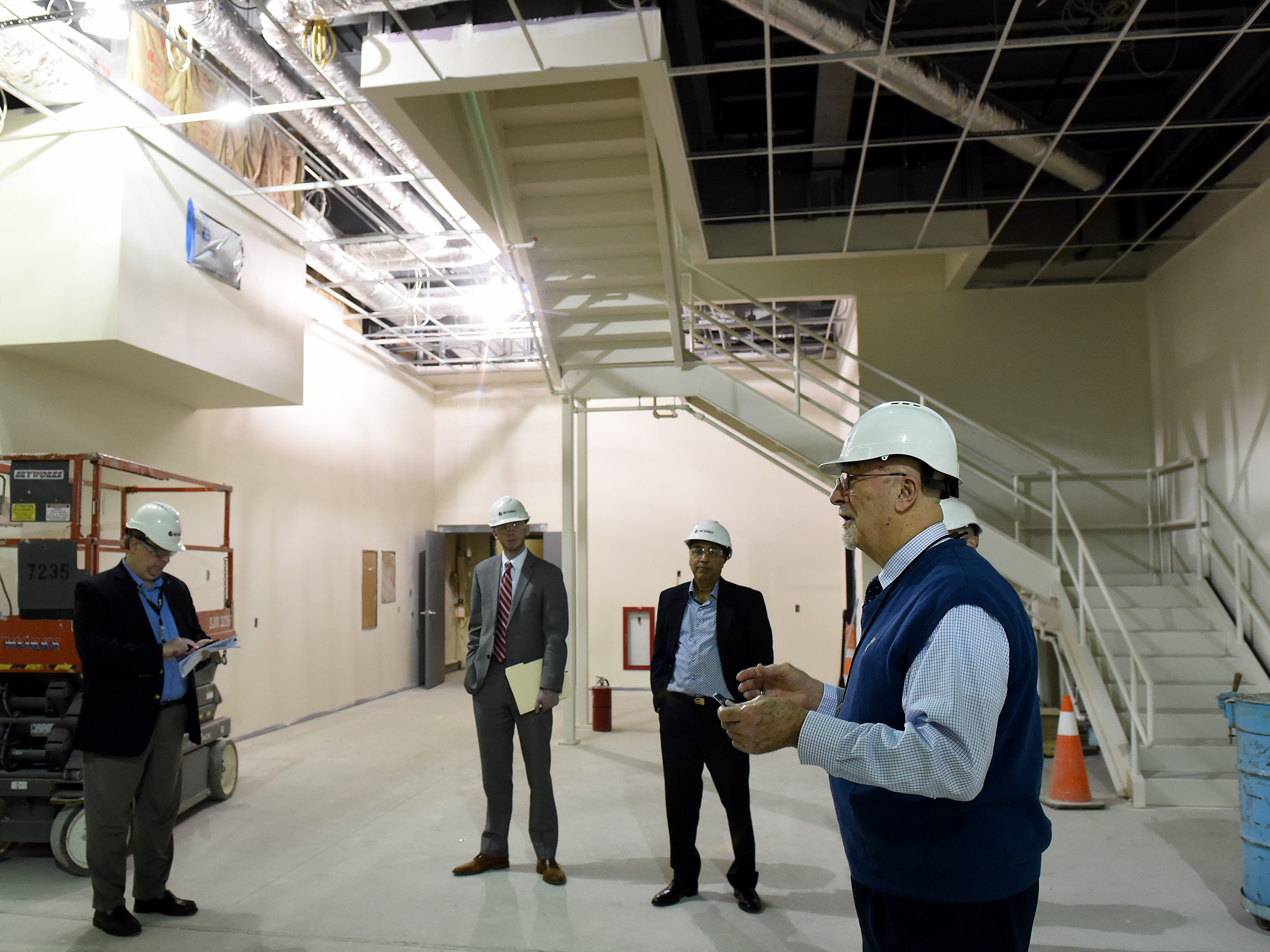 Ben Fullen, program director for Bionetics, explains the future plans for the Air Force Primary Standards Laboratory at the Port Authority campus in Heath. U.S. Rep. Troy Balderson, R-Zanesville, toured five companies at the growing Central Ohio Aerospace and Technology Center campus in Heath.
