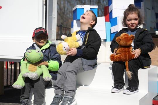 Preschoolers Brady Moran, Shane Wendolowski and Joseph Duarte participated in the Teddy Repair program at Jenn's Junction.