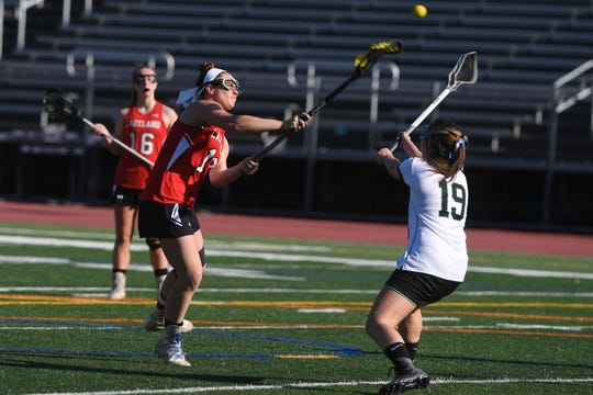 Lakeland girls lacrosse at Pascack Valley on Wednesday, April 3, 2019. L #19 Kendall Lomascola takes a shot.