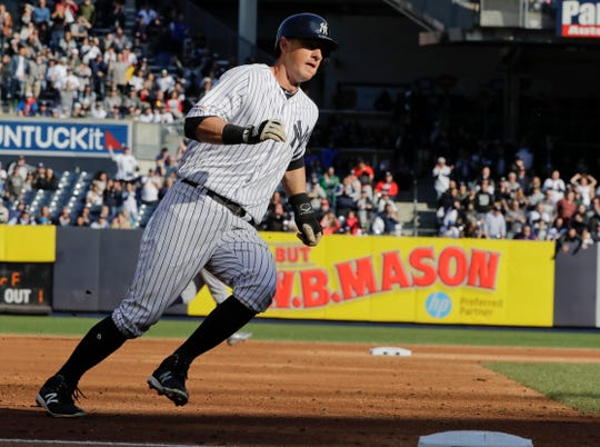 New York Yankees' DJ LeMahieu runs past third base to score on a single by Aaron Judge during the third inning of a baseball game against the Detroit Tigers Wednesday, April 3, 2019, in New York.