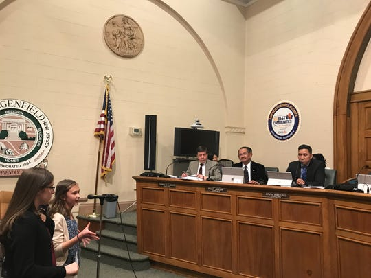 """Mia Fitzmaurice, 13, speaking at podium, and Nicole Ensmann, 14, both members of Bergenfield Girl Scouts Troop #94739, advocated""""Geese Crossing"""" signs near a local pond at the Bergenfield Borough Council meeting on April 3."""
