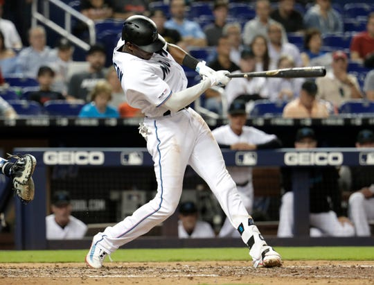 Miami Marlins' Lewis Brinson hits a double during the fourth inning of a baseball game against the New York Mets, Tuesday, April 2, 2019, in Miami. (AP Photo/Lynne Sladky)