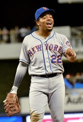 April 2, 2019; Miami, FL, USA; New York Mets first baseman Dominic Smith (22) reacts in the fifth inning against the Miami Marlins at Marlins Park. Mandatory Credit: Steve Mitchell-USA TODAY Sports