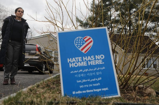 Poopak Mohajer poses for a photo, in front of her Paramus home. Mohajer, who moved to the U.S. in 2001, from Iran, has been trying to obtain permission for her brother to do the same since 2004.  Last year it looked as if it it would finally happen after countless letters and fees.  Then the ban started for Iran and four other countries. Tuesday, April, 2, 2019