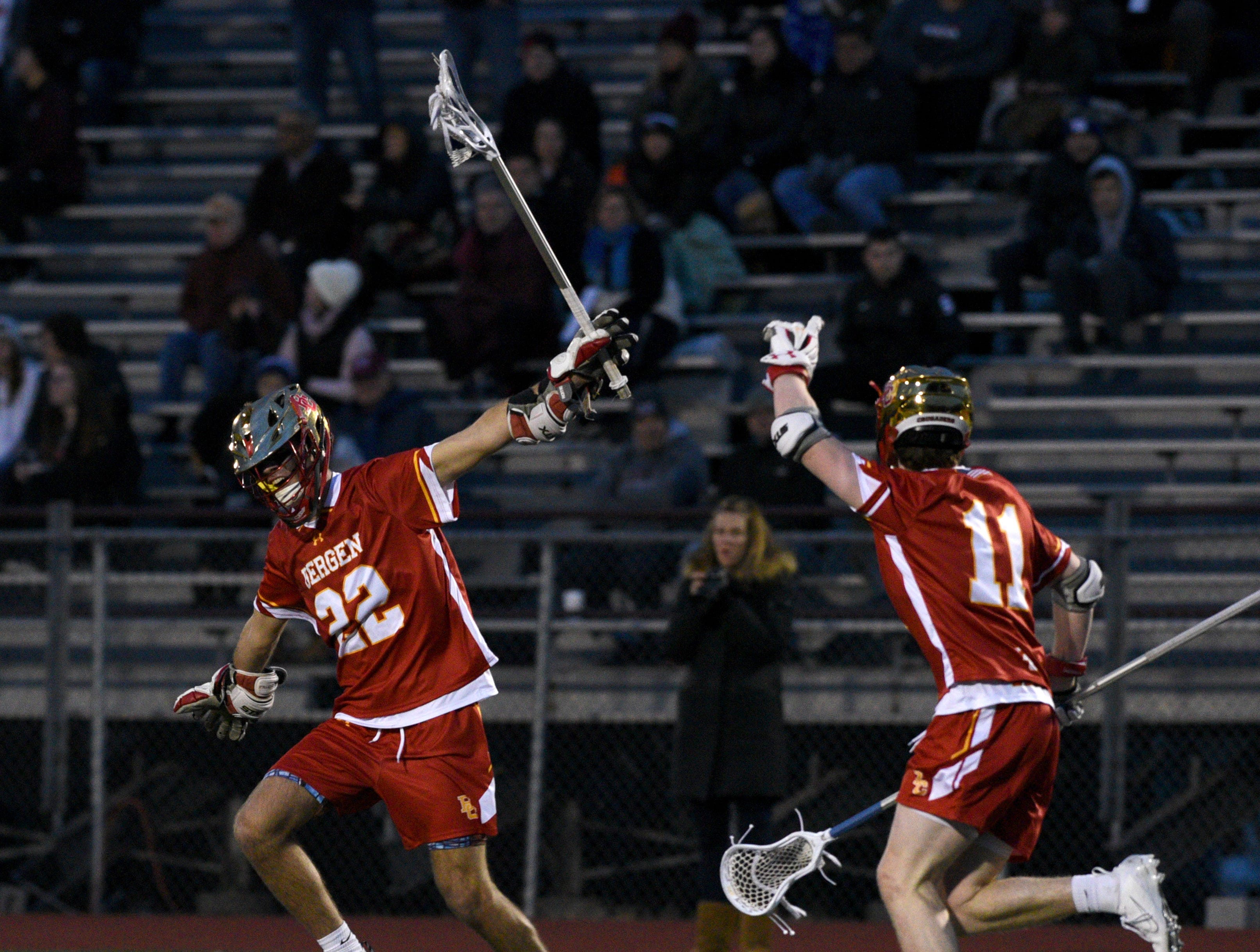 Don Bosco played Bergen Catholic at home in lacrosse on Tuesday, April 2, 2019. Thomas McGee #11 celebrates with Brett Zabransky #22 after McGee scores.