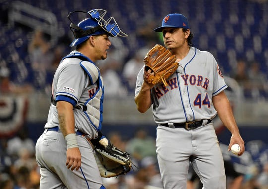 New York Mets starting pitcher Jason Vargas (right) talks with catcher Wilson Ramos (left) near the pitchers mound in the fifth inning against the Miami Marlins at Marlins Park.Sports