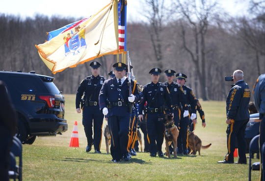 A Color Guard arrives during a memorial service for Leo, a member of the Passaic County Sheriff's K-9 unit, who died in the line of duty last week, photographed at Garret Mountain Reservation in Woodland Park on 4/3/19.
