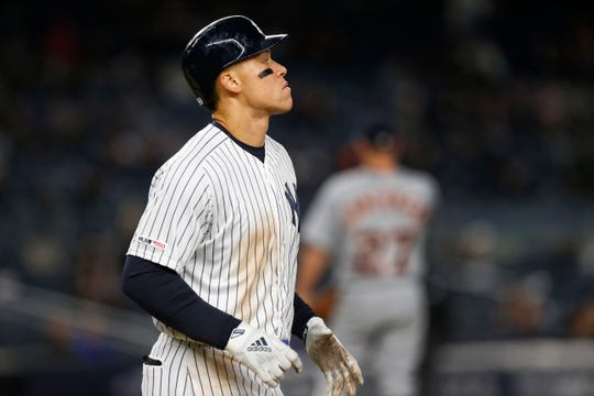Apr 2, 2019; Bronx, NY, USA; New York Yankees right fielder Aaron Judge (99) takes first base after an intentional walk by the Detroit Tigers in the fifth inning at Yankee Stadium.