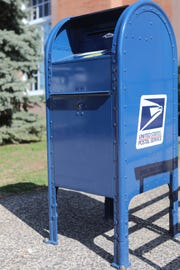 """This new mailbox, in front of the Ridgewood Post Office, prevents """"mail fishing"""", as it only has a thin slot for envelopes, as opposed to the pull down door, which gives thieves easier access.  Wednesday, April, 3, 2019"""