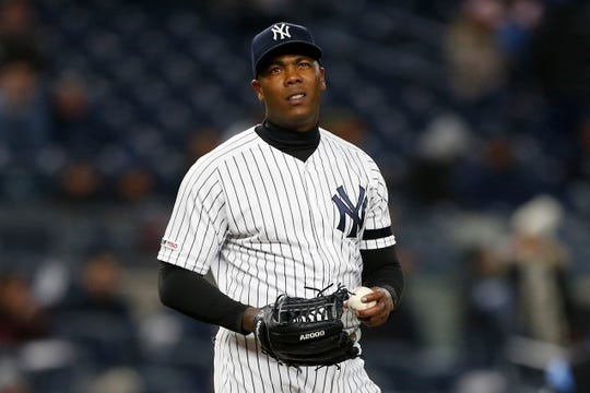 April 2, 2019; Bronx, NY, USA; New York Yankees relief pitcher Aroldis Chapman (54) reacts after giving up a run against the Detroit Tigers in the ninth inning at Yankee Stadium.