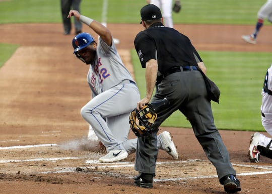 New York Mets' Dominic Smith (22) scores on a ground out by Juan Lagares during the first inning of a baseball game against the Miami Marlins, Tuesday, April 2, 2019, in Miami. (AP Photo/Lynne Sladky)