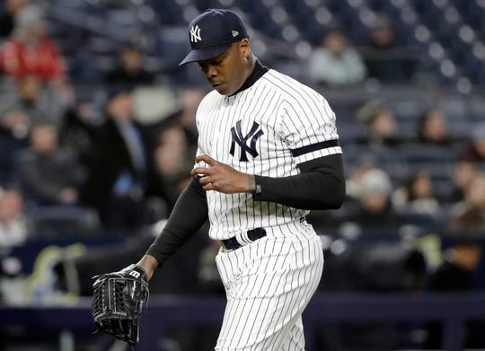 New York Yankees relief pitcher Aroldis Chapman (54) looks at his fingers after giving up two runs in the Yankees loss to the Detroit Tigers in the ninth inning of a baseball game, Tuesday, April 2, 2019, in New York.