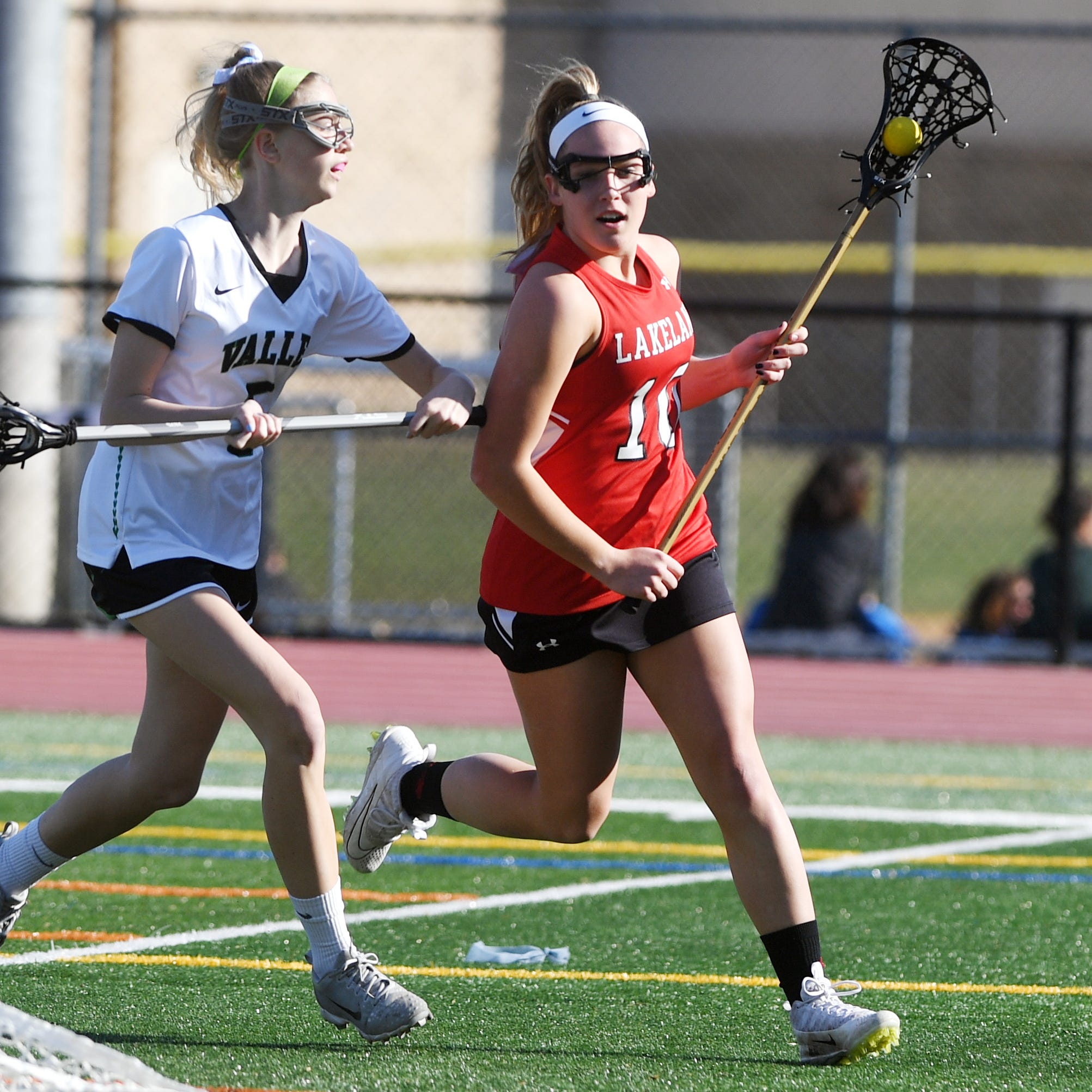 Lakeland girls lacrosse at Pascack Valley on Wednesday, April 3, 2019. L #10 Devyn Tanajewski tries to get past PV #5 Kelly Andreasen.