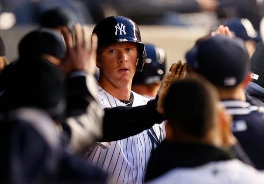 Apr 2, 2019; Bronx, NY, USA;  New York Yankees second baseman DJ LeMahieu (26) celebrates in the dugout after scoring against the Detroit Tigers in the second inning at Yankee Stadium.