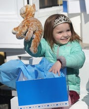 Eliorah Melen, 4, removes her stuffed animal, named Kitty, from a box at Jenn's Junction, a preschool in North Haledon, after it was cleaned by Lysol for the company's inaugural Teddy Repair program.
