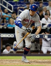 New York Mets' Brandon Nimmo tosses his bat after drawing a walk during the fifth inning of a baseball game against the Miami Marlins, Tuesday, April 2, 2019, in Miami. (AP Photo/Lynne Sladky)