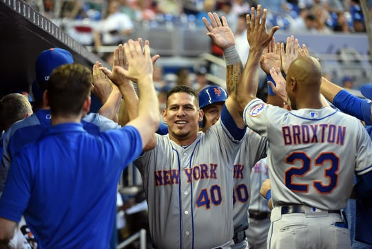 Apr 2, 2019; Miami, FL, USA; New York Mets catcher Wilson Ramos (40) is congratulated by teammates after scoring in the first inning against the Miami Marlins at Marlins Park.