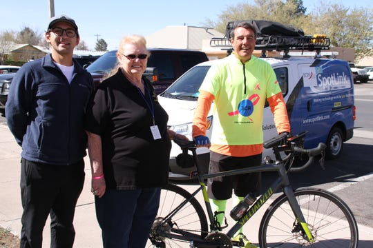 Alan Joelson, left, and cyclist Bob Hood met and interviewed Deming-Luna-Mimbres Museum Gift Shop Manager Punkin Gose during their 3 Country Ride  fundraiser for the Breast Cancer Research Foundation.