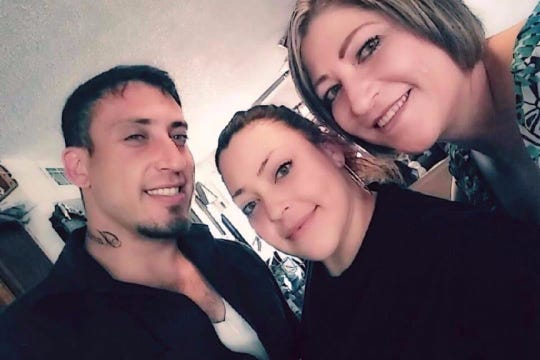 Lorenza Nuñez, far right, stands for a photo with her two children, Anthony and Jessica Granados.